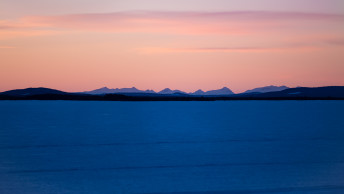Distant mountains of frozen lake - Sweden